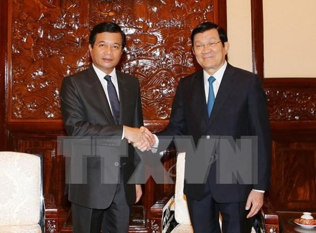 越南国家主席张晋创会见老挝驻越大使 hinh anh 1
