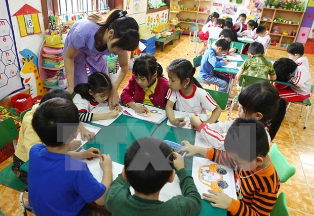 越南举办关于儿童与家庭问题的国际座谈会 hinh anh 1