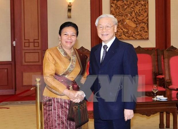 越共中央总书记阮富仲会见老挝人民革命党中央对外部代表团 hinh anh 1