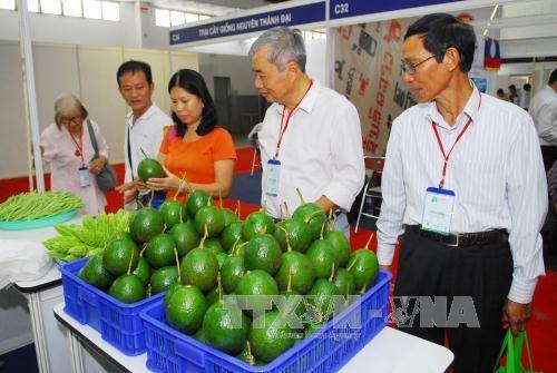 近100家企业参加2015年越南国际农业与农产品展销会 hinh anh 1