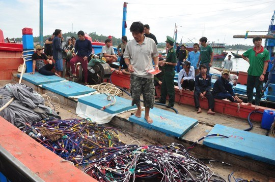 越南渔业工会强烈反对中国渔政船攻击越南渔船和掠夺船上财产 hinh anh 1