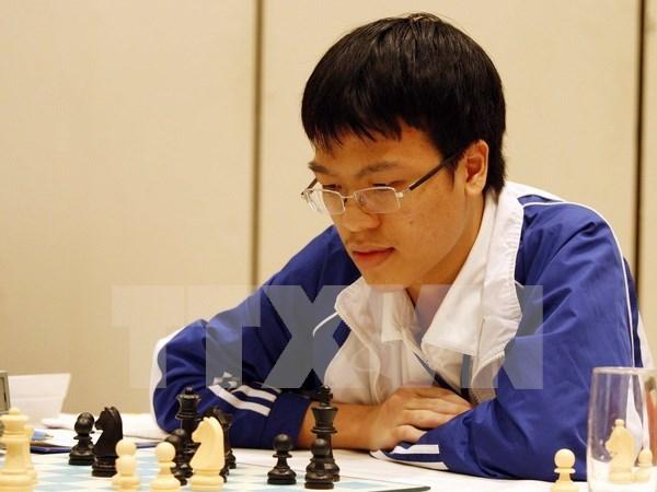 百万美元国际象棋公开赛:黎光廉战平卫冕冠军挺进半决赛 hinh anh 1