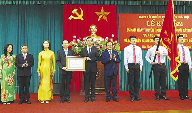 越南河内市市委组织部举行党组织部门传统日85周年纪念典礼 hinh anh 1