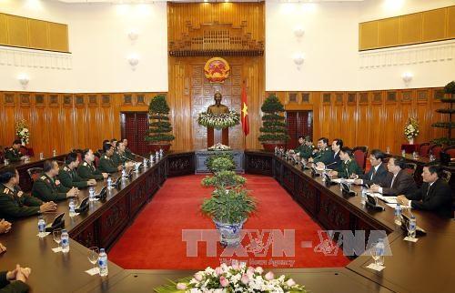 越南政府总理阮晋勇会见老挝人民军总参谋长苏旺 hinh anh 1