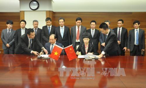 越中经贸合作委员会第九次会议在北京召开 hinh anh 1