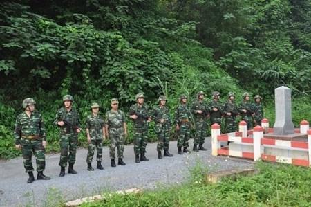 越南老街省和中国云南省边防力量进行2015年第五次联合巡逻 hinh anh 1