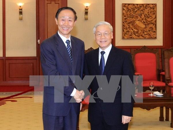 阮富仲总书记会见中国全国政协副主席、中联部部长王家瑞 hinh anh 1