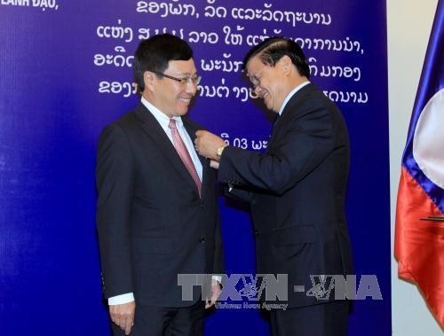 越老两国政府副总理兼外长共同主持召开第二次外长级磋商 hinh anh 3