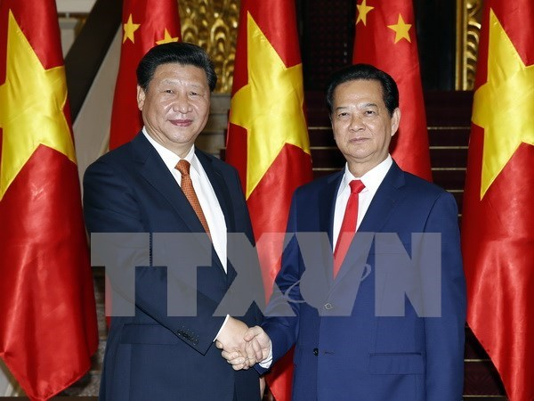 越南政府总理阮晋勇会见中共中央总书记、国家主席习近平 hinh anh 1