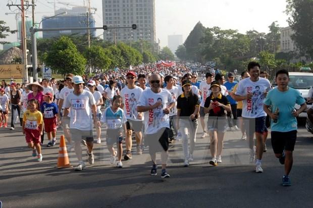 1.8万人参加在胡志明市举行的特里·福克斯义跑活动 hinh anh 1