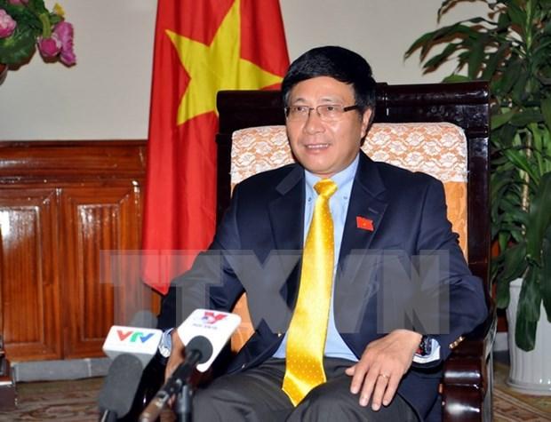 越南政府副总理兼外长范平明:东盟共同体建设进程中的越南烙印 hinh anh 1