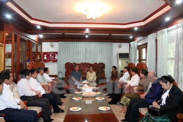 越共中央书记处常务书记黎鸿英看望慰问原老挝高级领导人 hinh anh 1