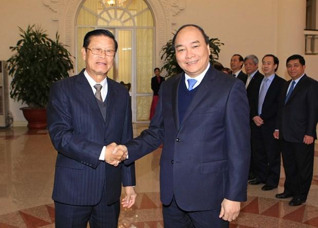 越南政府副总理阮春福与老挝政府副总理宋沙瓦举行会谈 hinh anh 1