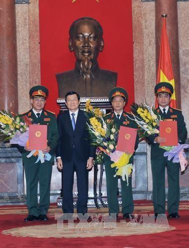 越南国家主席张晋创向越南人民军三名将官颁发晋升军衔决定 hinh anh 1