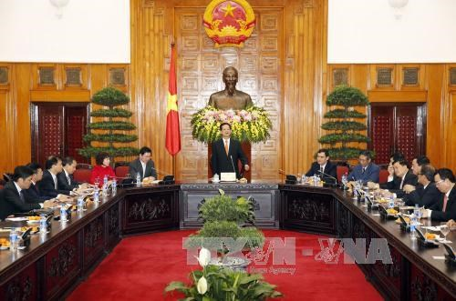 越南政府总理阮晋勇会见工商企业代表团 hinh anh 1