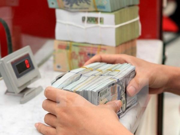 越南国家银行上调越盾对美元汇率 hinh anh 1