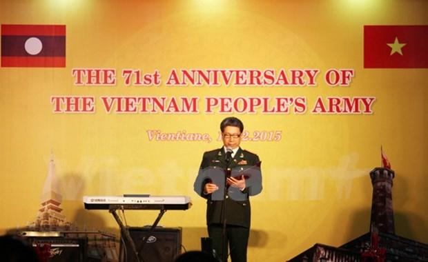 越南人民军建军71周年纪念典礼在老挝举行 hinh anh 1
