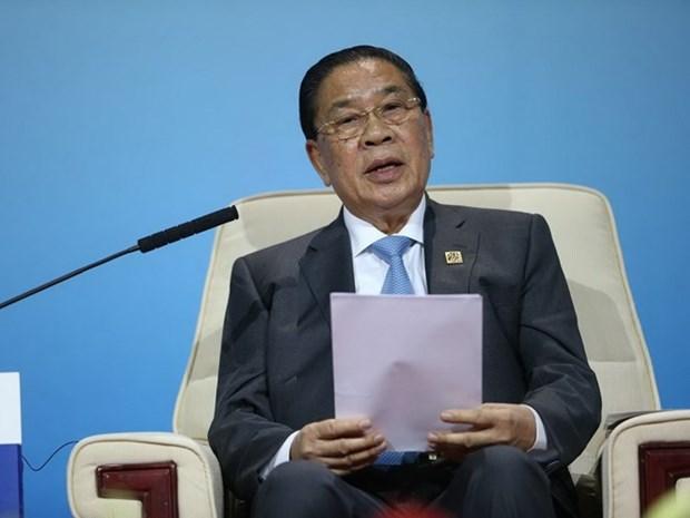 老挝国家主席朱马里·赛雅颂签署主席令公布2015年宪法 hinh anh 1
