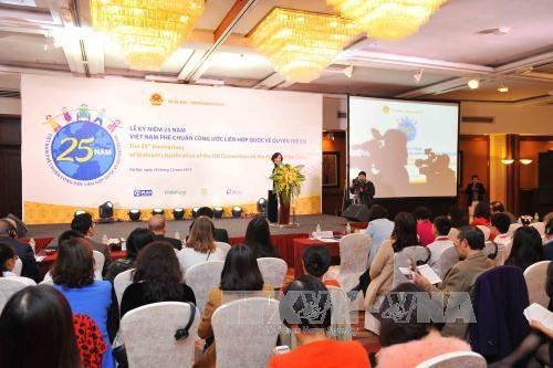 越南批准联合国《儿童权利公约》25周年纪念典礼在河内举行 hinh anh 1