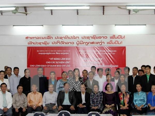 越南协助老挝新闻工作者提高业务水平 hinh anh 1