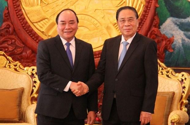 老挝领导高度重视与越南的特殊团结与合作关系 hinh anh 1