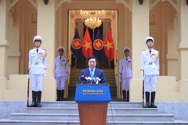 越南隆重举行东盟旗升旗仪式庆祝东盟共同体正式成立 hinh anh 3