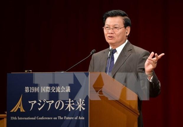东盟共同体建成:老挝热烈欢迎东盟共同体建成 hinh anh 2