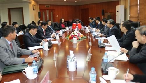 越南烈士遗骸寻找归宿国家指导委员会访问中国 hinh anh 1