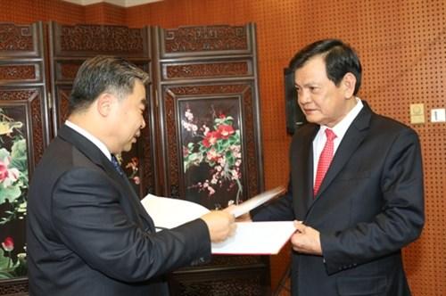 越南烈士遗骸寻找归宿国家指导委员会访问中国 hinh anh 2