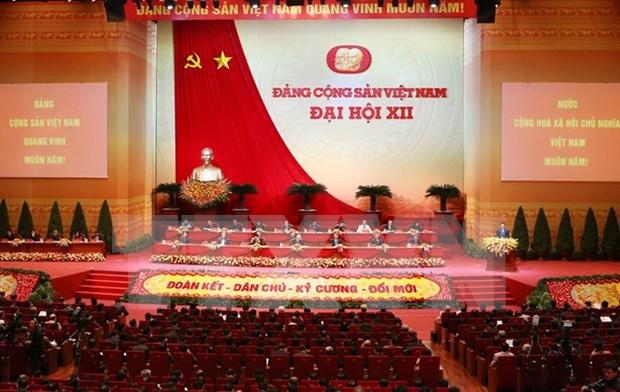 越南共产党第十二次全国代表大会第三天新闻公报 hinh anh 1