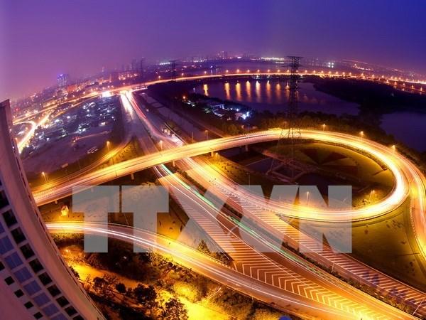 越共十二大:国际舆论高度评价越南经济前景 hinh anh 2