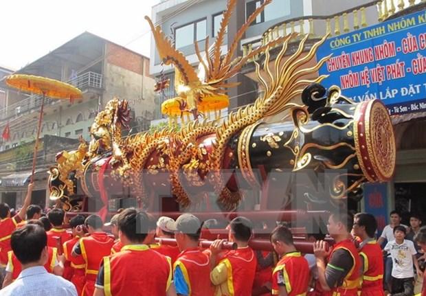 北宁省有执村拔河节和同骑村传统庙会正式成为国家非物质文化遗产 hinh anh 2