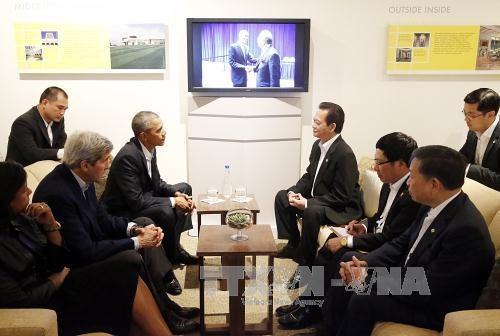 越南政府总理阮晋勇会见美国总统奥巴马 hinh anh 2