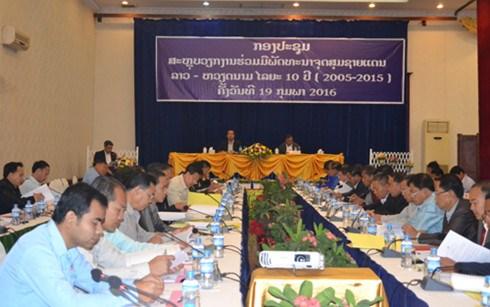 老挝举行越老边境地区合作与发展项目10周年总结会议 hinh anh 1