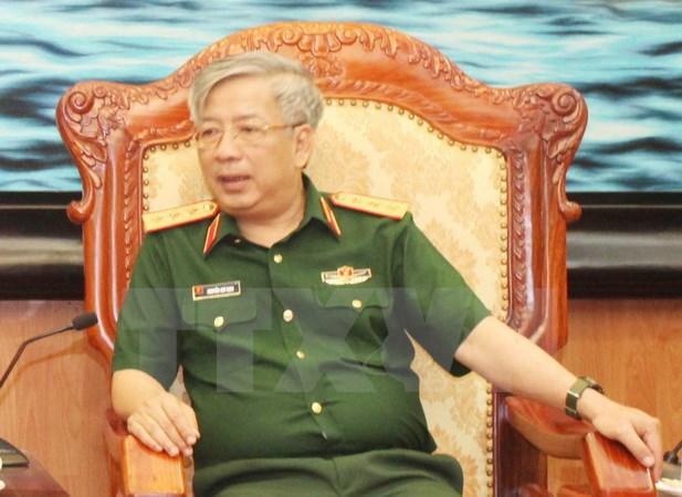 越南和新加坡一致同意扩大防务合作 hinh anh 1