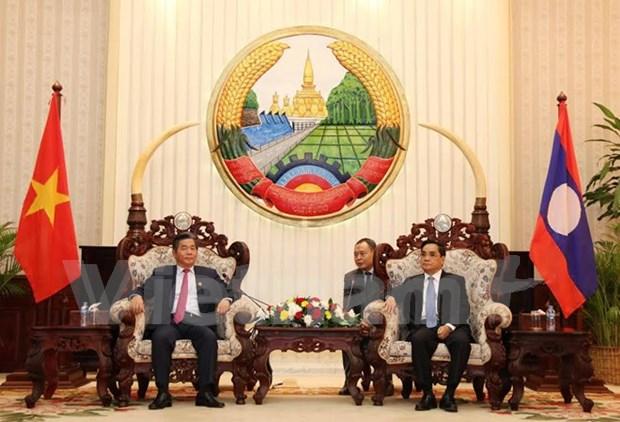 老挝领导人高度评价老越计划投资部的合作结果 hinh anh 1