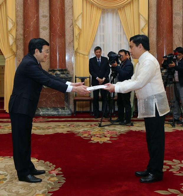 越南国家主席张晋创接受四国新任驻越大使递交国书 hinh anh 3
