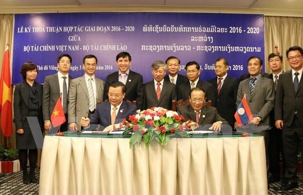 越南与老挝财政部加强合作 hinh anh 1