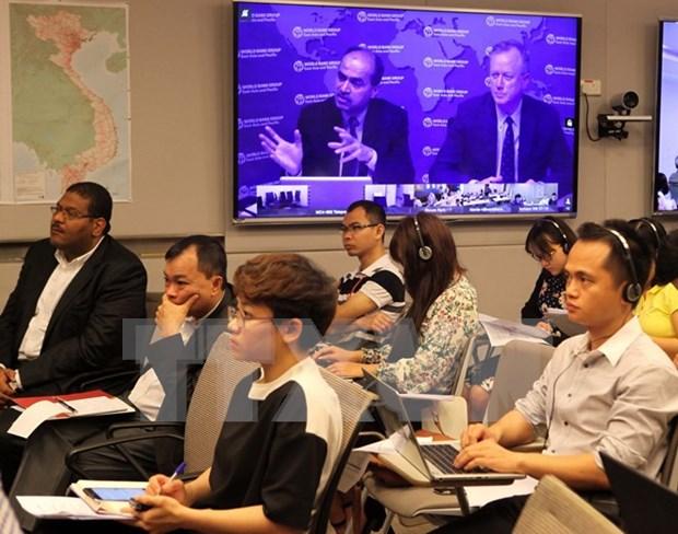 世行发表半年一次的东亚和太平洋地区经济形势报告 hinh anh 1