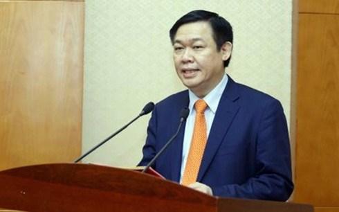 越南政府副总理王廷惠:制定安全风险评估工具 健全金融市场监测机制 hinh anh 1