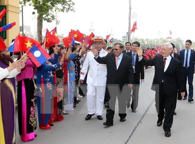 老挝人民革命党中央总书记、国家主席本扬·沃拉吉向越南党和国家领导人致感谢电 hinh anh 1