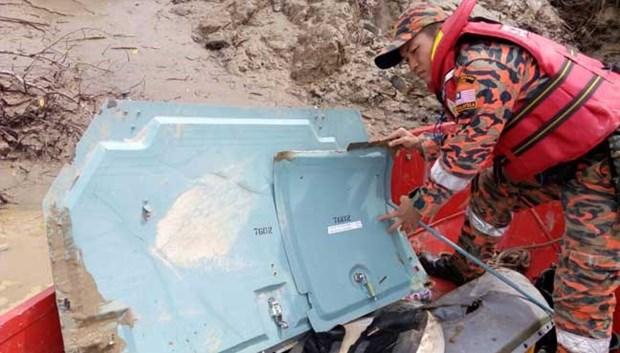 马来西亚直升机失联事件:已找到残骸与一具妇女尸体 hinh anh 1