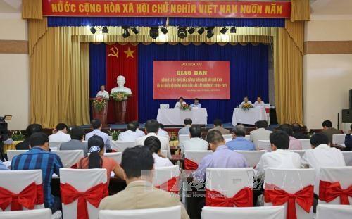越南南部地区19个省市选举工作交班会在平阳省举行 hinh anh 1