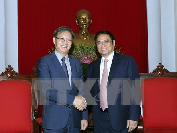 越共中央组织部部长范明正会见老挝新任驻越大使 hinh anh 1