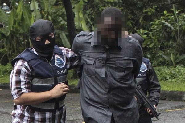 马来西亚警方逮捕14名涉IS嫌犯 hinh anh 1