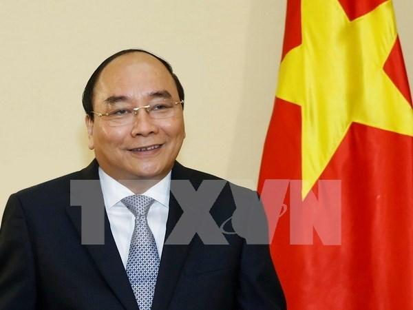 阮春福总理赴日出席日本G7峰会扩大会议前夕接受日本媒体专访 hinh anh 1