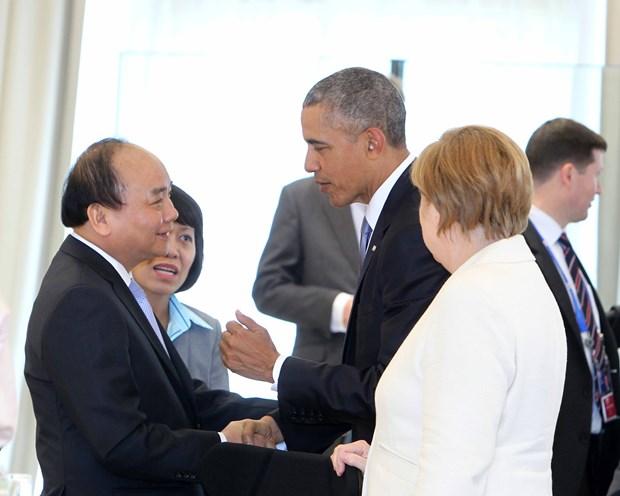越南政府总理阮春福七国集团峰会期间与各国元首举行双边会晤 hinh anh 5
