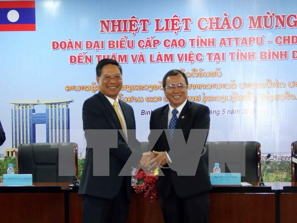 老挝阿速坡省赴越南平阳省考察投资合作环境 hinh anh 1