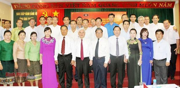 越南平福省和老挝阿速坡省促进投资与合作 hinh anh 1