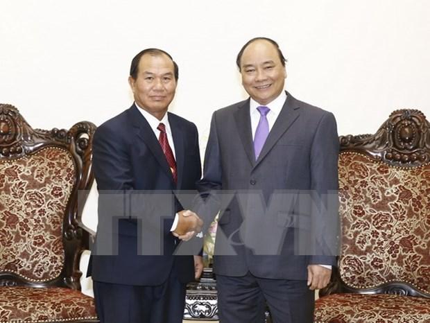 越南政府总理阮春福会见老挝司法部部长桑蒂冯 hinh anh 1